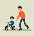 parenting father teaches his son to ride a vector image vector image
