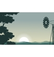 Silhouette of windmill and tree on the morning vector image vector image