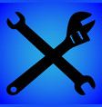 wrench silhouette isolated on blue background vector image vector image
