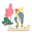 farmer woman in overalls working in garden digging vector image vector image