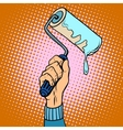Hand holding paint roller vector image vector image