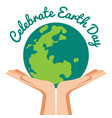 hand holding world with celebrated earth day text vector image