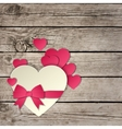 heart with a bow on a wooden background vector image