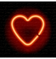 neon heart on brick wall vector image