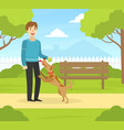 young man walking with dog in summer park in sunny vector image