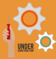 hand with tool and under construction equipment vector image vector image