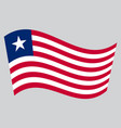 flag of liberia waving on gray background vector image vector image