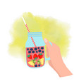 hand holding mason jar with strawberry blueberry vector image vector image