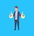 business man holding bags with money successful vector image vector image