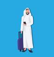 arabic businessman using smartphone holding valise vector image vector image
