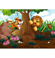 A tiger and a lion playing at the forest vector image