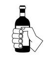 hand holding wine bottle vector image
