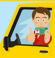 young boy showing his new driver license vector image vector image