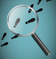 Magnifying glass and footprints vector image