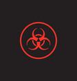 red biohazard symbol on black background vector image vector image