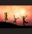 silhouettes of children playing in sunset vector image vector image