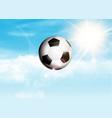 soccer or football flying through a blue sunny sky vector image vector image