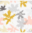 abstract maple leaves seamless pattern in gold vector image