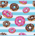seamless pattern with yummy donuts on striped vector image