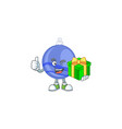 shiny blue christmas ball cartoon with character vector image vector image
