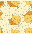 autumnal leaves seamless pattern in yellow and vector image