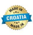 made in Croatia gold badge with blue ribbon vector image vector image