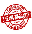 5 years warranty round red grunge stamp vector image