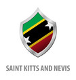 saint kitts and nevis flag on metal shiny shield vector image