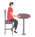 woman sitting with cup at table leisure vector image vector image
