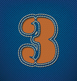 Number 3 made from leather on jeans background vector image