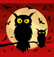 two owls on a tree branch and bats vector image