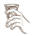 male hand holds glass of whiskey with ice vector image