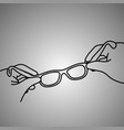 close-up hand of businessman holding eye glasses vector image