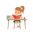 cute girl sitting at the desk and reading a book vector image vector image