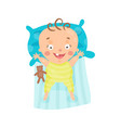 cute cartoon smiling baby lying in his bed vector image vector image
