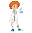 Boy in white coat holding beaker