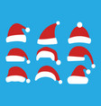 set of christmas hats isolated on blue background vector image