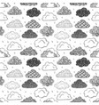 seamless background with black doodle clouds on vector image vector image