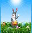 easter bunny holding a basket with easter egg and vector image vector image