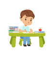 cute little boy character sitting at the table and vector image vector image