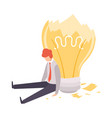 overworked man sitting with broken light bulb vector image vector image