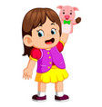girl was using cute pig puppet vector image