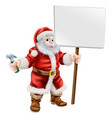 santa holding hammer and sign vector image vector image