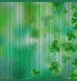 st patricks day shamrocks over a green wood vector image