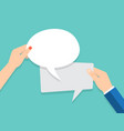 hand holding an empty speech bubble vector image vector image