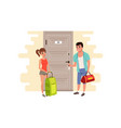young couple standing in front of the door of the vector image vector image