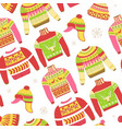 knitted sweaters and warm winter hat seamless vector image