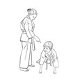 young karate boy and girl vector image vector image