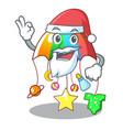 santa baby playing with cartoon hanging toys vector image