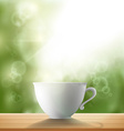white cup standing on a wooden table in the garden vector image